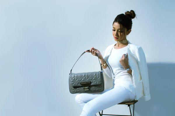 Attractive Woman with Designer Handbags